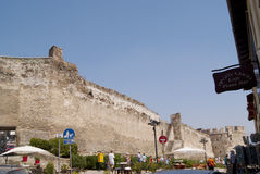 Thessaloniki. The view of the Thessaloniki old wall with the shops nearby and people Royalty Free Stock Images