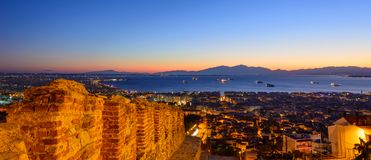 Thessaloniki view from the bird`s flight. Thessaloniki view of the sea castle sunset evening city ships gulf royalty free stock images