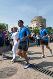 Thessaloniki welcomes Olympic Torch. THESSALONIKI, GREECE - MAY 13: The arrival of the Olympic torch in front of the White Tower. The Olympic flame will travel Stock Photo