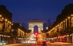 TheTriumphal arch and Champs Elysees avenue,Paris. The Triumphal Arch andChamps elysees avenue at night, Paris, France stock photo