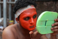 Theyyam artist does make up Royalty Free Stock Photo