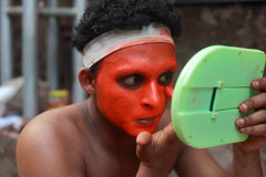 Theyyam artist does make up Stock Image