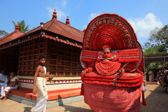 Theyyam artist. An unidentified Theyyam artist performs at Kadannappalli Muchilot Bhagavati temple on January 05, 2015 in Kannur, India.Theyyam is a ritualistic Stock Image