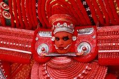 Theyyam artist. An unidentified Theyyam artist performs at Kadannappalli Muchilot Bhagavati temple on January 05, 2015 in Kannur, India.Theyyam is a ritualistic Stock Photography
