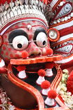 Theyyam dance. A theyyam dance performer giving facial expression. Theyyam  is a unique artform of north Kerala in India Stock Photo