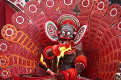 Theyyam dance. A Theyyam performer dancing with fire. Theyyam  is a unique artform of north Kerala in India Stock Image