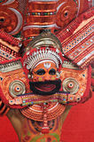 Theyyam ritual in Kerala,INdia on Nov 28th,2011. KANNUR, INDIA - NOVEMBER 28, 2011: an unidentified Theyyam performer in full costume during a performance of royalty free stock photo