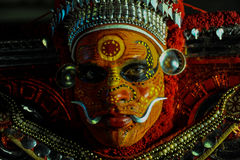 Theyyam is a ritualistic folk art form of Kerala Stock Photography