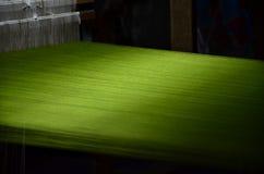 Thia Silk. A close up of green Thai silk line. A folk wisdom of Thai villagers Royalty Free Stock Image