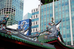 Thian Hock Keng Temple roof and modern skyscrapers stock photo