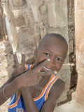 Thiaroye, Senegal, Africa � August 2, 2014: Unidentified boy standing in the street Royalty Free Stock Photo