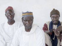 Thiaroye, Senegal, Africa – July 18, 2014: Unidentified Muslim men sitting in front of the Grand Mosque of Thiaroye Stock Image