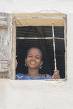 Thiaroye, Senegal, Africa – July 18, 2014: Unidentified young woman standing at the window of her  house Stock Photo