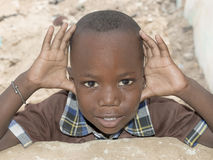 Thiaroye, Senegal, Africa – August 2, 2014: Unidentified boy standing in the street, popular district of Guinaw Rails Stock Image