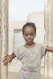 Thiaroye, Senegal, Africa – July 30, 2014: Unidentified girl standing at the door of her house Royalty Free Stock Photography