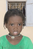 Thiaroye, Senegal, Africa – July 24, 2014: Unidentified little girl standing in the street Royalty Free Stock Photo