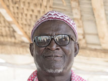 Thiaroye, Senegal, Africa – July 18, 2014: Unidentified Muslim man entering the Grand Mosque Stock Image