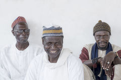 Thiaroye, Senegal, Africa – July 18, 2014: Unidentified Muslim men sitting in front of the Grand Mosque of Thiaroye Royalty Free Stock Photography