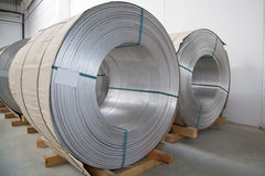 Thick aluminium wire spool. Thick aluminium wire sopools in wire stretching factory Stock Photo