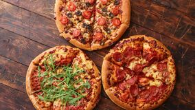 Thick american style homemade on fluffy dough pizzas stock video footage