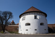 Thick bastion. Thick medieval bastion building today functions as a theaterin Sibiu, Romania royalty free stock images
