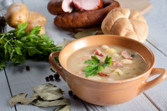 Thick bean soup with traditional sausage Stock Images