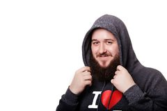 Thick beard and mustache guy in a hood smiling. Isolated on whit Royalty Free Stock Image