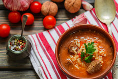 Thick beef soup with rice, tomatoes, carrots, peppers, walnuts and spices. Kharcho soup. A traditional dish of Georgian cuisine. Stock Image