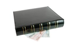 Thick black book on euro bills isolated Royalty Free Stock Photos