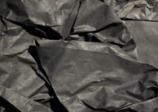 Thick Black Paper Crumpled. Close up of thick black semi gloss paper crumpled up with harsh shadows Royalty Free Stock Photography