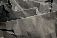 Thick Black Paper Folded. Close up of thick black semi gloss paper folds with strong shadows Stock Image
