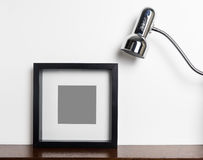 Thick black photo frame with light lamp stock photo