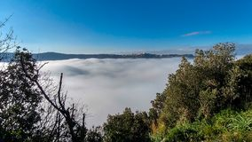 A thick blanket of fog has covered the crater of Lake Albano in Royalty Free Stock Image