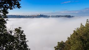 A thick blanket of fog has covered the crater of Lake Albano in Stock Image