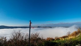 A thick blanket of fog has covered the crater of Lake Albano in Stock Photo