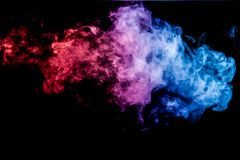 Background of smoke vape. Thick blue and red colorful smoke of on a black isolated background. Background from the smoke of vape royalty free stock photography