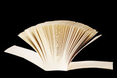 Thick book on black background Stock Photography