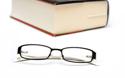 Thick book and glasses Stock Image