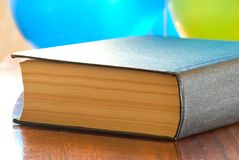 Thick book on a polished table Stock Photo