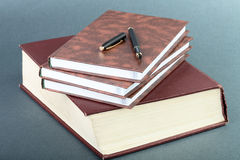 Thick book volume notebooks and pen Royalty Free Stock Photos
