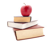 The thick books and apple Stock Photo