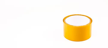 Thick brown plastic tape in white big core Royalty Free Stock Photo