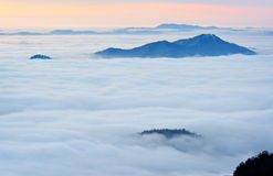 Thick clouds over the mountains Royalty Free Stock Image