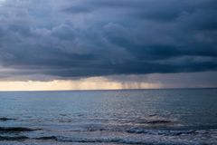 Storm over ocean, approaching beach royalty free stock photography