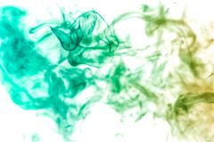 Background from the smoke of vape. Thick colorful smoke of green on a white isolated background. Background from the smoke of vape royalty free stock images