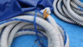 Thick cords lying on ground, bungee jumping equipment, extreme sport activity. Stock footage stock video footage