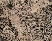 Thick craft paper with doodle pattern. Sheet of thick brown craft paper with doodle pattern of flowers, curves and dots on it Stock Photos