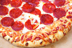 Thick crust peperoni pizza. Homemade Thick crust pepperoni pizza golden crust and lot's of cheese Stock Image