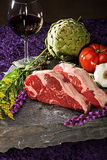 Thick cut, juicy, raw New York steaks Royalty Free Stock Photos