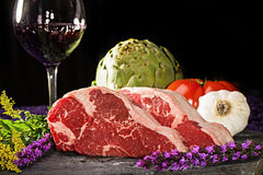 Thick cut, juicy, raw New York steaks Stock Photo